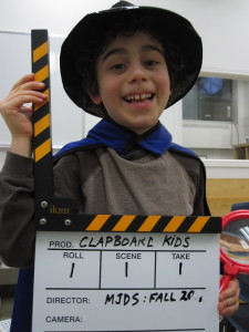 Clapboard student holds a film clapboard!